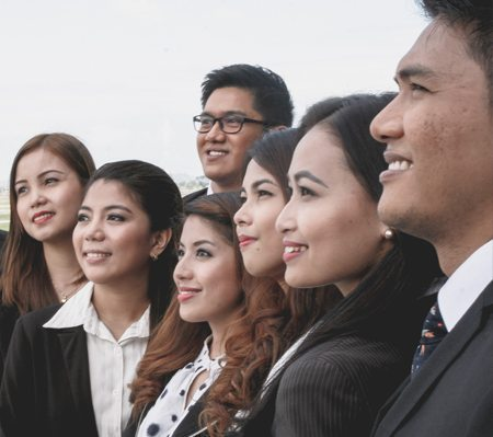 A group of corporate people looking towards the horizon